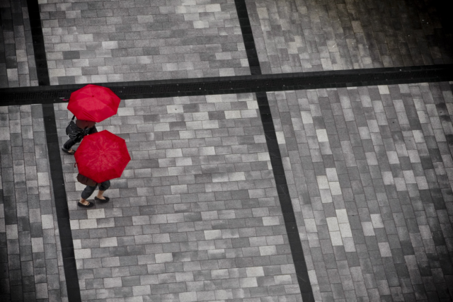 two_red_umbrellas